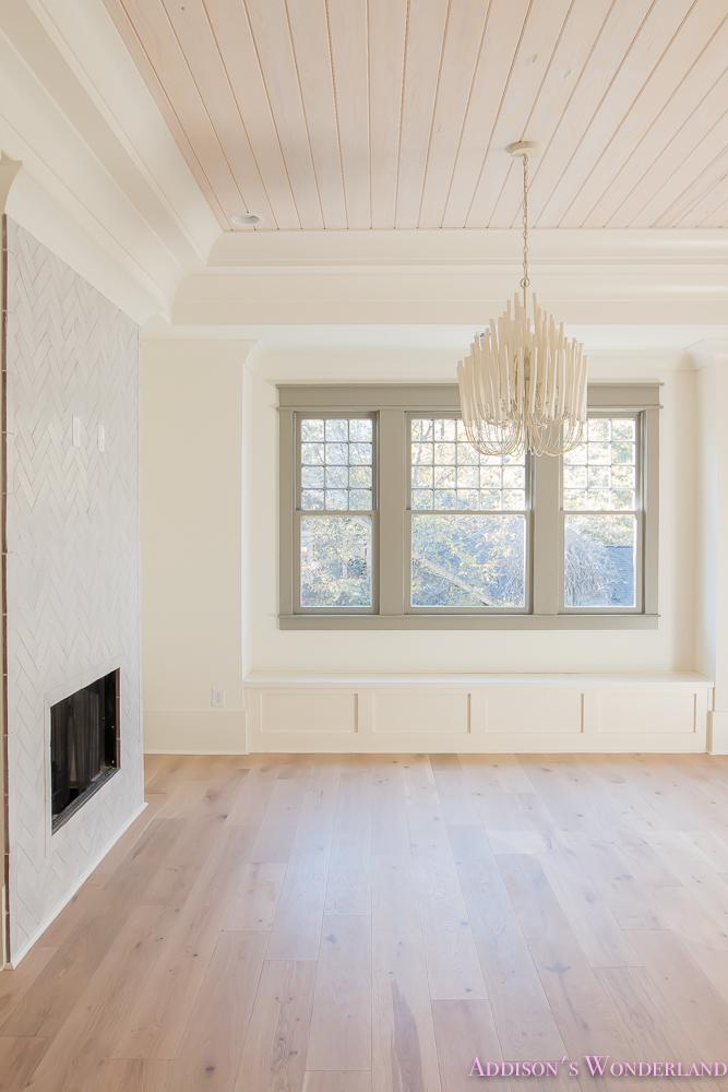 playroom-living-room-whitewashed-hardwood-floors-flooring-ceiling-rose-pink-doors-iron-baluster-staircase-white-walls-alabaster-sherwin-williams-7-of-19