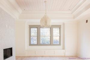 playroom-living-room-whitewashed-hardwood-floors-flooring-ceiling-rose-pink-doors-iron-baluster-staircase-white-walls-alabaster-sherwin-williams-8-of-19
