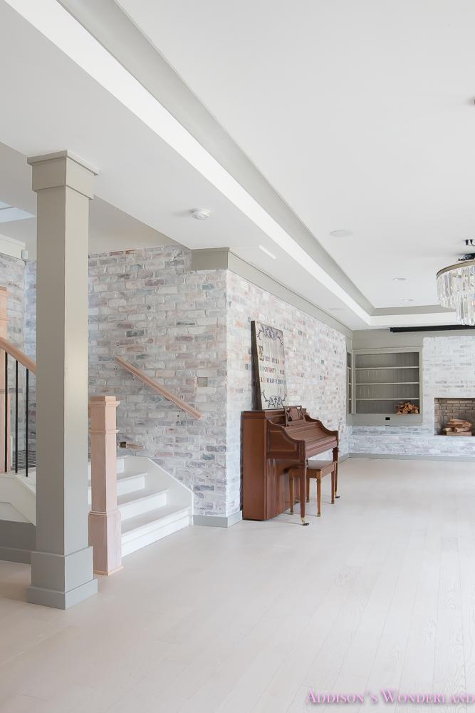 basement-whitewashed-brick-limewash-walls-hardwood-shaw-flooring-floor-dorian-gray-sherwin-williams-alabaster-lantern-crystal-chandelier-10-of-22
