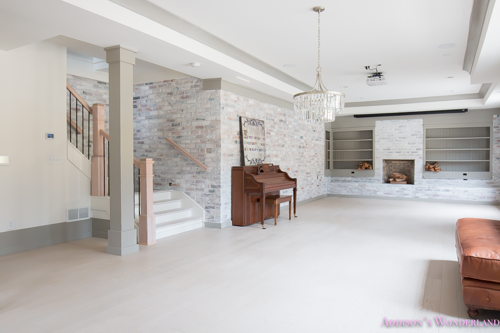 basement-whitewashed-brick-limewash-walls-hardwood-shaw-flooring-floor-dorian-gray-sherwin-williams-alabaster-lantern-crystal-chandelier-11-of-22