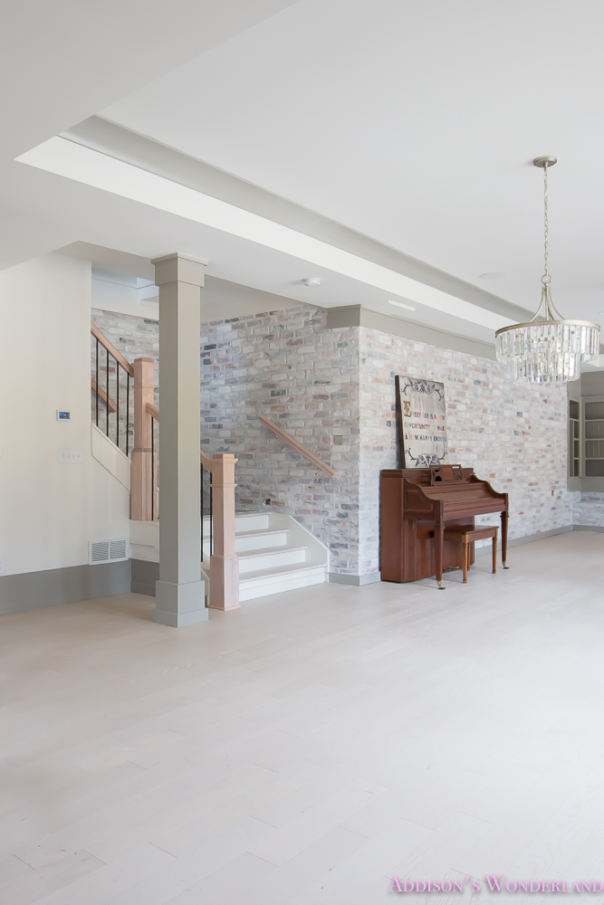 basement-whitewashed-brick-limewash-walls-hardwood-shaw-flooring-floor-dorian-gray-sherwin-williams-alabaster-lantern-crystal-chandelier-12-of-22