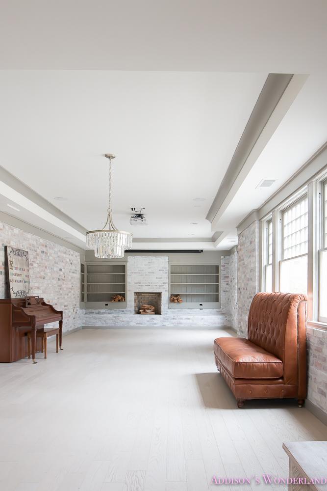 basement-whitewashed-brick-limewash-walls-hardwood-shaw-flooring-floor-dorian-gray-sherwin-williams-alabaster-lantern-crystal-chandelier-13-of-22