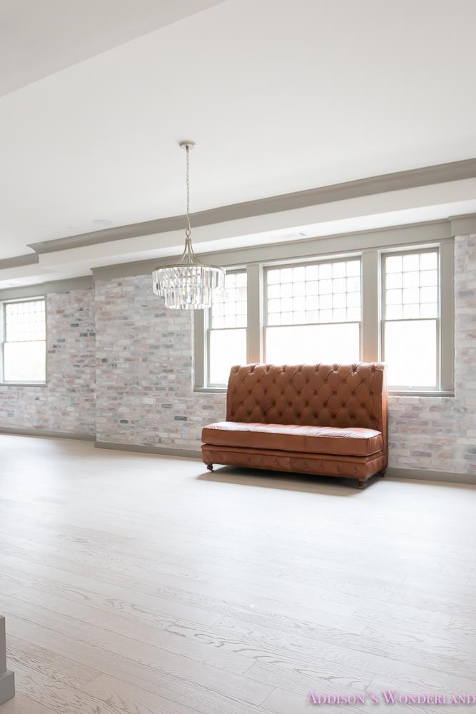 basement-whitewashed-brick-limewash-walls-hardwood-shaw-flooring-floor-dorian-gray-sherwin-williams-alabaster-lantern-crystal-chandelier-15-of-22