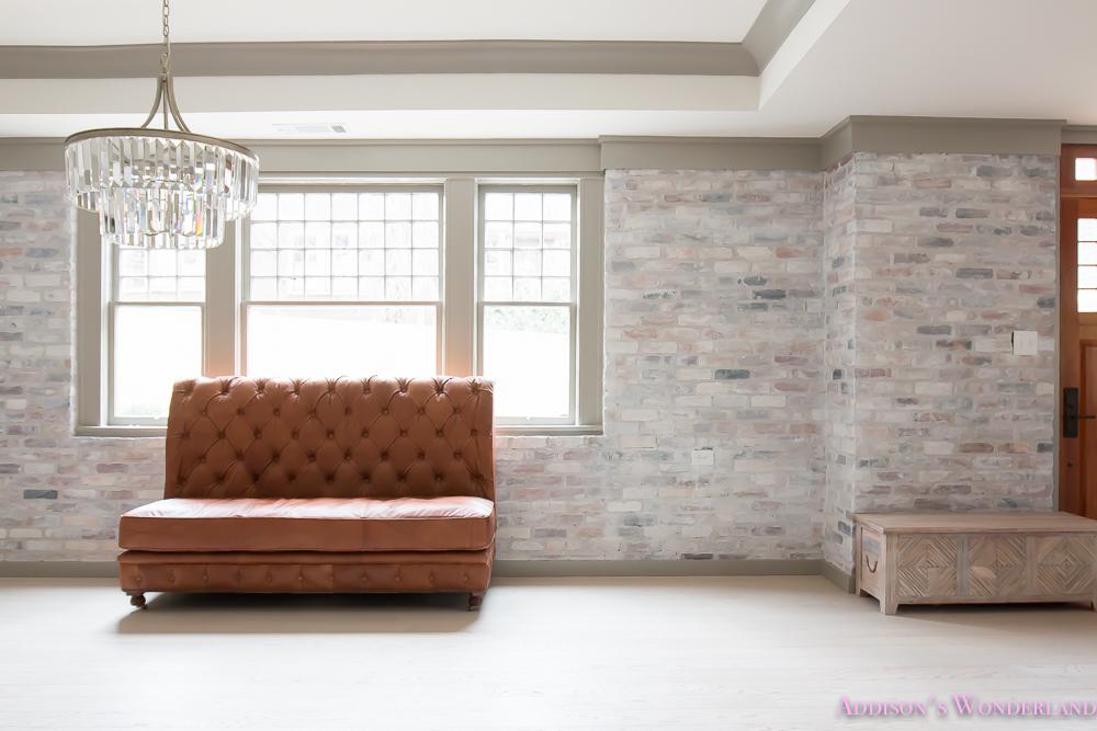 basement-whitewashed-brick-limewash-walls-hardwood-shaw-flooring-floor-dorian-gray-sherwin-williams-alabaster-lantern-crystal-chandelier-16-of-22