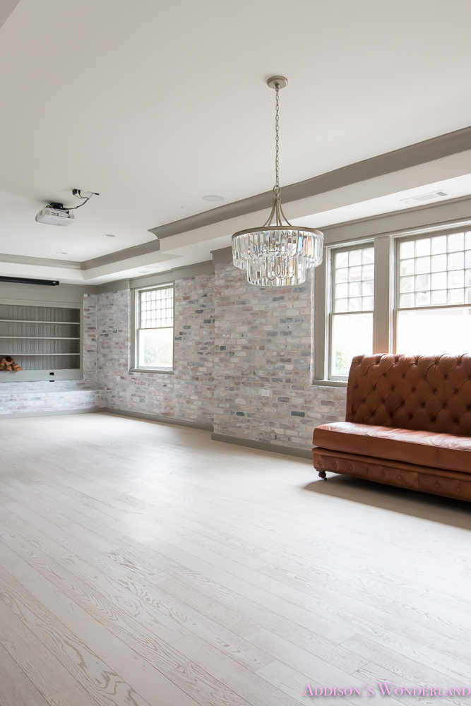 basement-whitewashed-brick-limewash-walls-hardwood-shaw-flooring-floor-dorian-gray-sherwin-williams-alabaster-lantern-crystal-chandelier-17-of-22