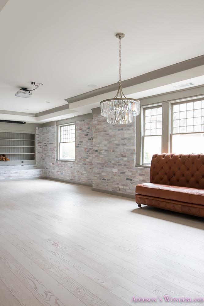 basement-whitewashed-brick-limewash-walls-hardwood-shaw-flooring-floor-dorian-gray-sherwin-williams-alabaster-lantern-crystal-chandelier-17-of-22
