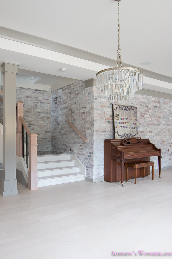 basement-whitewashed-brick-limewash-walls-hardwood-shaw-flooring-floor-dorian-gray-sherwin-williams-alabaster-lantern-crystal-chandelier-18-of-22