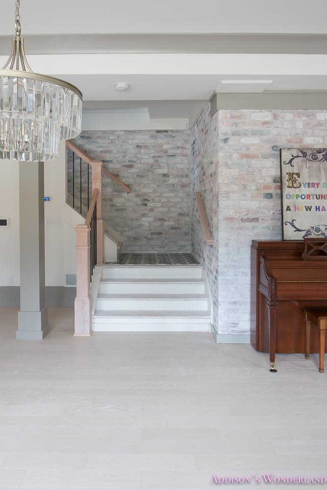 basement-whitewashed-brick-limewash-walls-hardwood-shaw-flooring-floor-dorian-gray-sherwin-williams-alabaster-lantern-crystal-chandelier-19-of-22