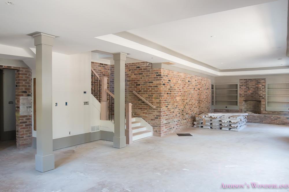 basement-whitewashed-brick-limewash-walls-hardwood-shaw-flooring-floor-dorian-gray-sherwin-williams-alabaster-lantern-crystal-chandelier-2-of-22