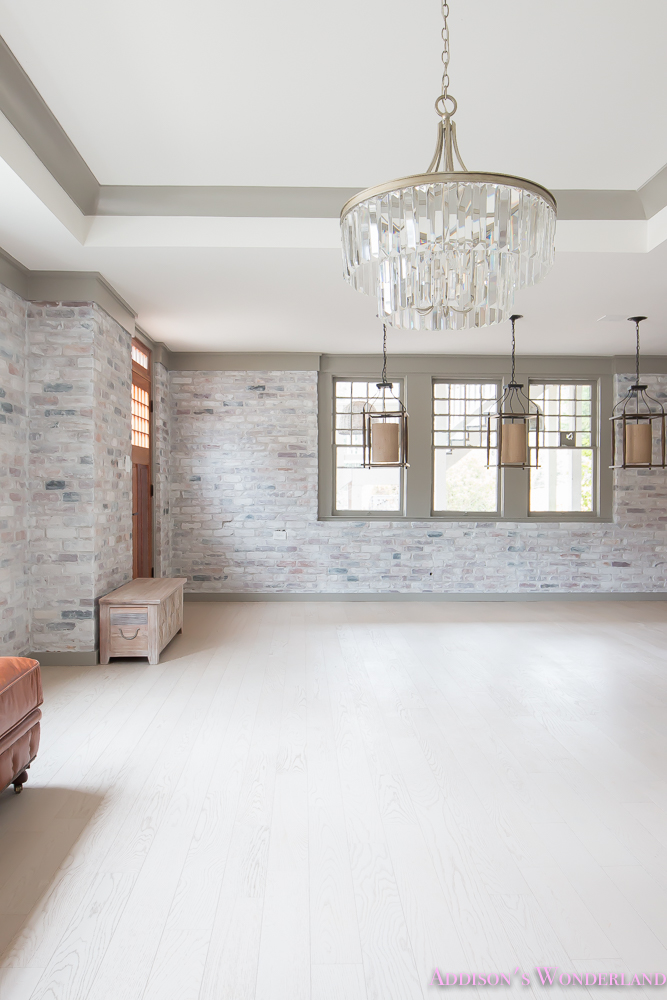 basement-whitewashed-brick-limewash-walls-hardwood-shaw-flooring-floor-dorian-gray-sherwin-williams-alabaster-lantern-crystal-chandelier-21-of-22