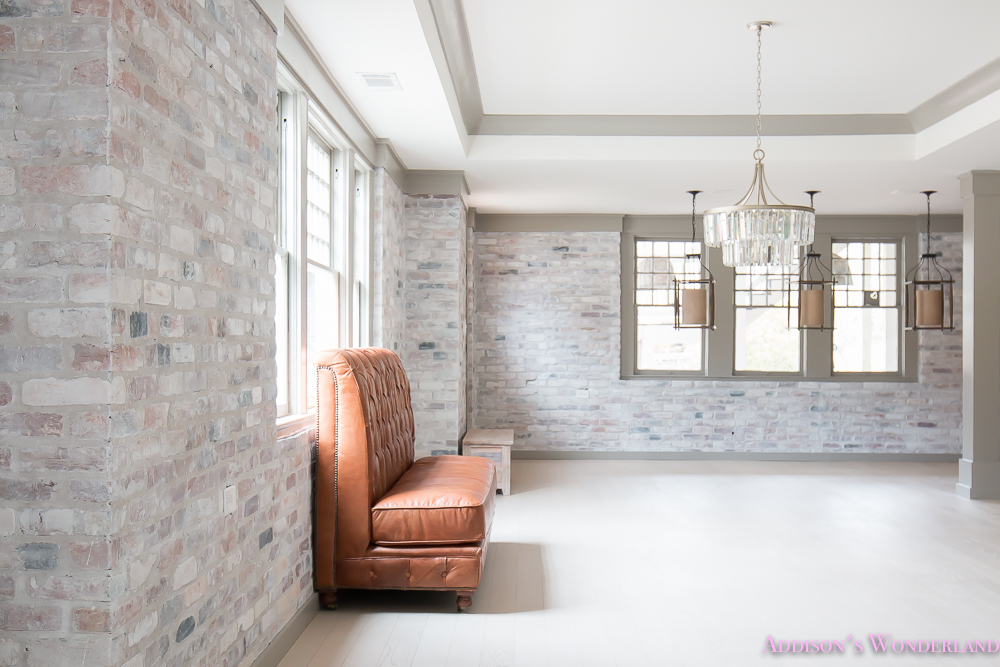 basement-whitewashed-brick-limewash-walls-hardwood-shaw-flooring-floor-dorian-gray-sherwin-williams-alabaster-lantern-crystal-chandelier-22-of-22
