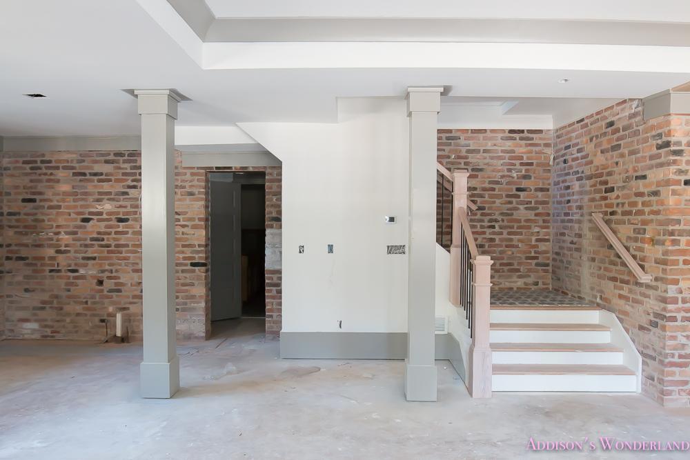 basement-whitewashed-brick-limewash-walls-hardwood-shaw-flooring-floor-dorian-gray-sherwin-williams-alabaster-lantern-crystal-chandelier-3-of-22