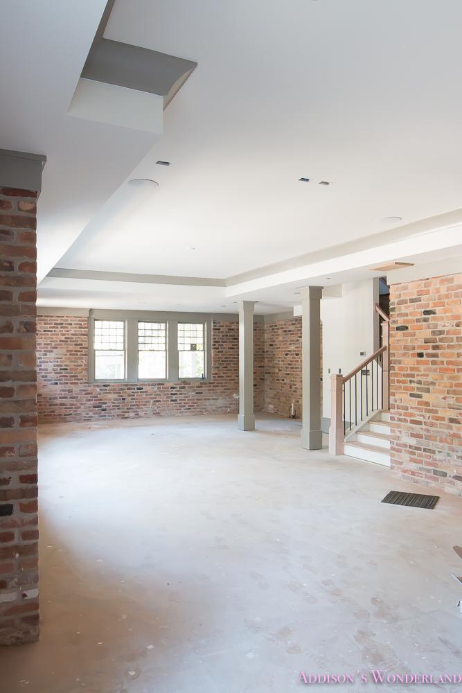 basement-whitewashed-brick-limewash-walls-hardwood-shaw-flooring-floor-dorian-gray-sherwin-williams-alabaster-lantern-crystal-chandelier-4-of-22