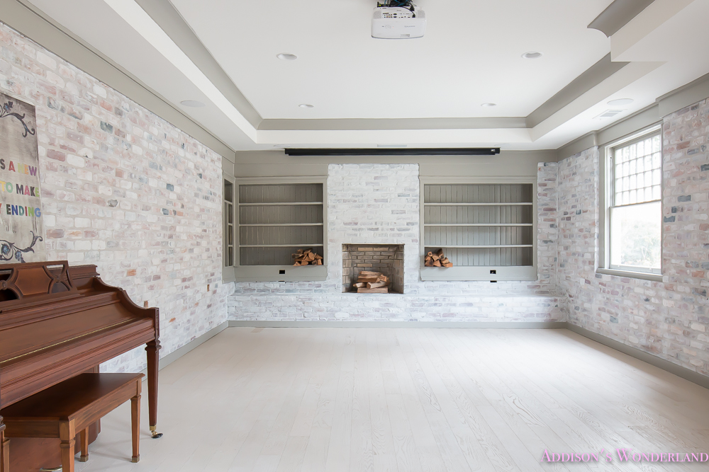 basement-whitewashed-brick-limewash-walls-hardwood-shaw-flooring-floor-dorian-gray-sherwin-williams-alabaster-lantern-crystal-chandelier-5-of-22