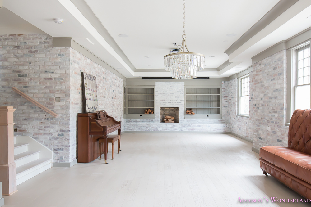 basement-whitewashed-brick-limewash-walls-hardwood-shaw-flooring-floor-dorian-gray-sherwin-williams-alabaster-lantern-crystal-chandelier-7-of-22