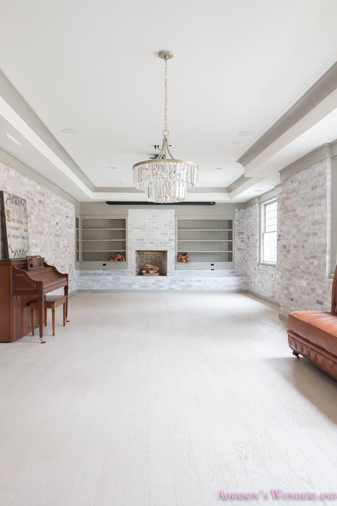 basement-whitewashed-brick-limewash-walls-hardwood-shaw-flooring-floor-dorian-gray-sherwin-williams-alabaster-lantern-crystal-chandelier-8-of-22