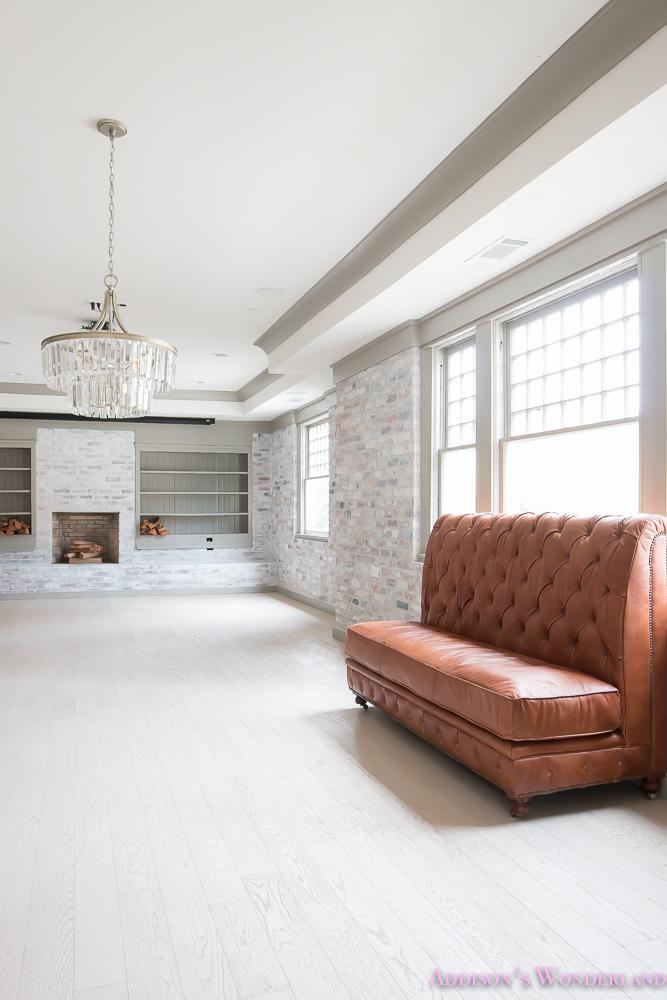 basement-whitewashed-brick-limewash-walls-hardwood-shaw-flooring-floor-dorian-gray-sherwin-williams-alabaster-lantern-crystal-chandelier-9-of-22