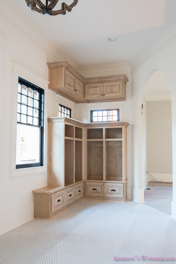 mud-room-coat-rack-shoe-storage-built-in-cabinets-white-penny-round-tile-shaw-floors-black-window-sashes-alabaster-sherwin-williams-11-of-15