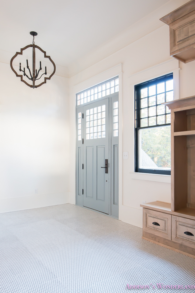mud-room-coat-rack-shoe-storage-built-in-cabinets-white-penny-round-tile-shaw-floors-black-window-sashes-alabaster-sherwin-williams-3-of-15