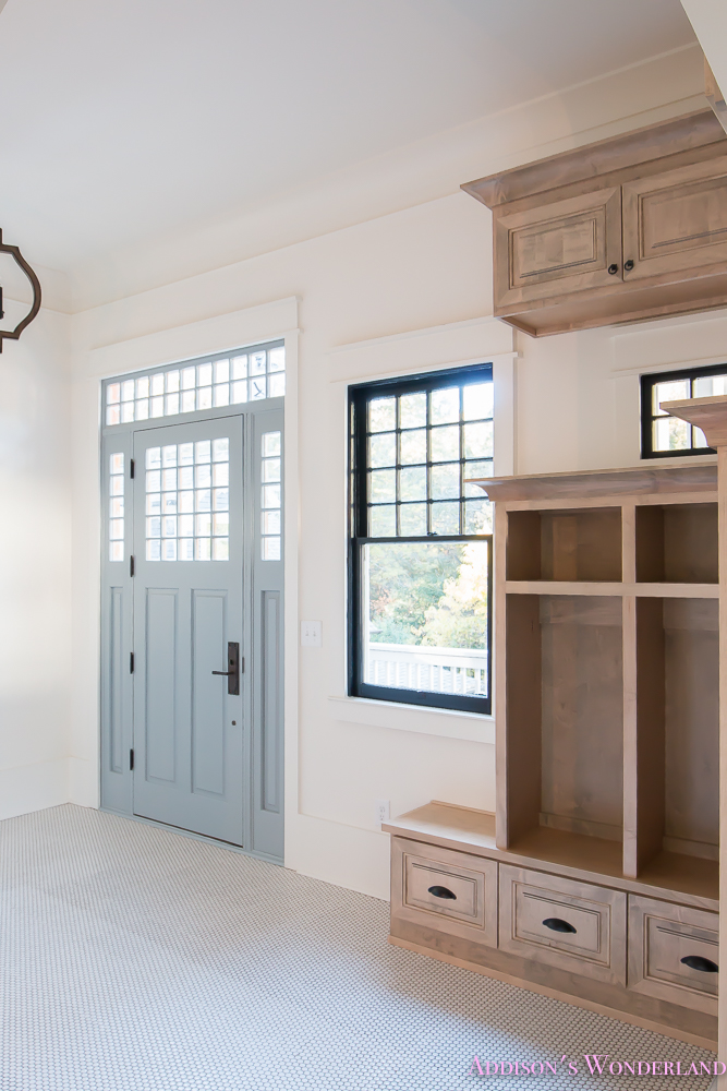 mud-room-coat-rack-shoe-storage-built-in-cabinets-white-penny-round-tile-shaw-floors-black-window-sashes-alabaster-sherwin-williams-7-of-15