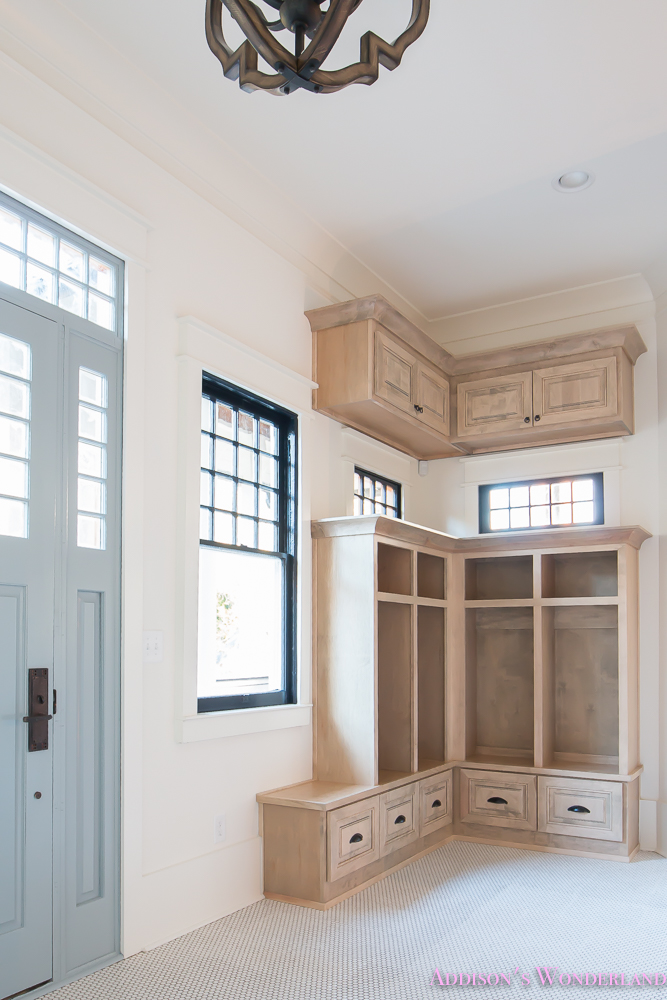 mud-room-coat-rack-shoe-storage-built-in-cabinets-white-penny-round-tile-shaw-floors-black-window-sashes-alabaster-sherwin-williams-9-of-15