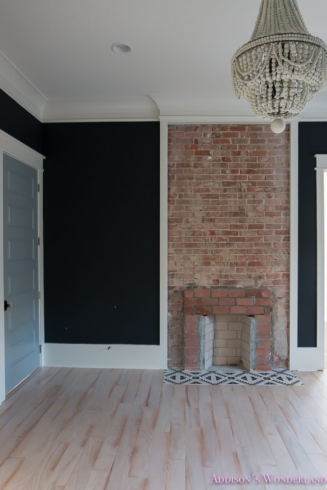Master Bedroom Black Walls Shaw Hardwood Whitewashed Wood Floors Brick Fireplace White Beaded Chandelier 3 Of 7