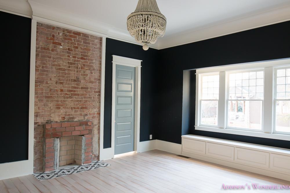 master-bedroom-black-walls-shaw-hardwood-whitewashed-wood-floors-brick-fireplace-white-beaded-chandelier-5-of-7
