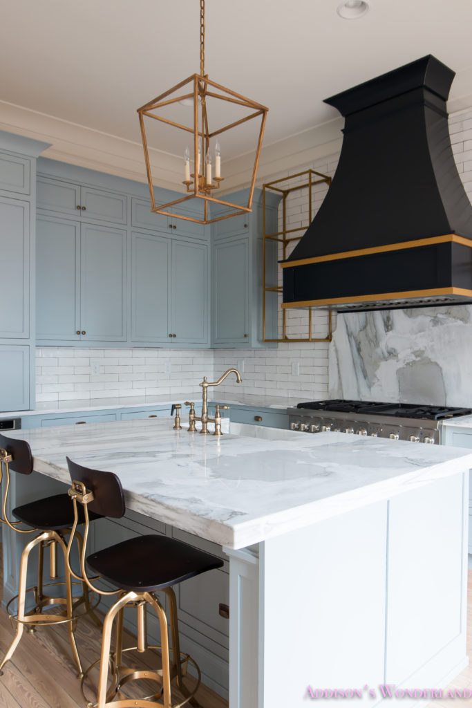 a-classic-vintage-modern-kitchen-blue-gray-cabinets-inset-shaker-black-gold-vent-hood-antique-brass-faucet-white-subway-backsplash-tile-gold-open-shelves-11-of-16