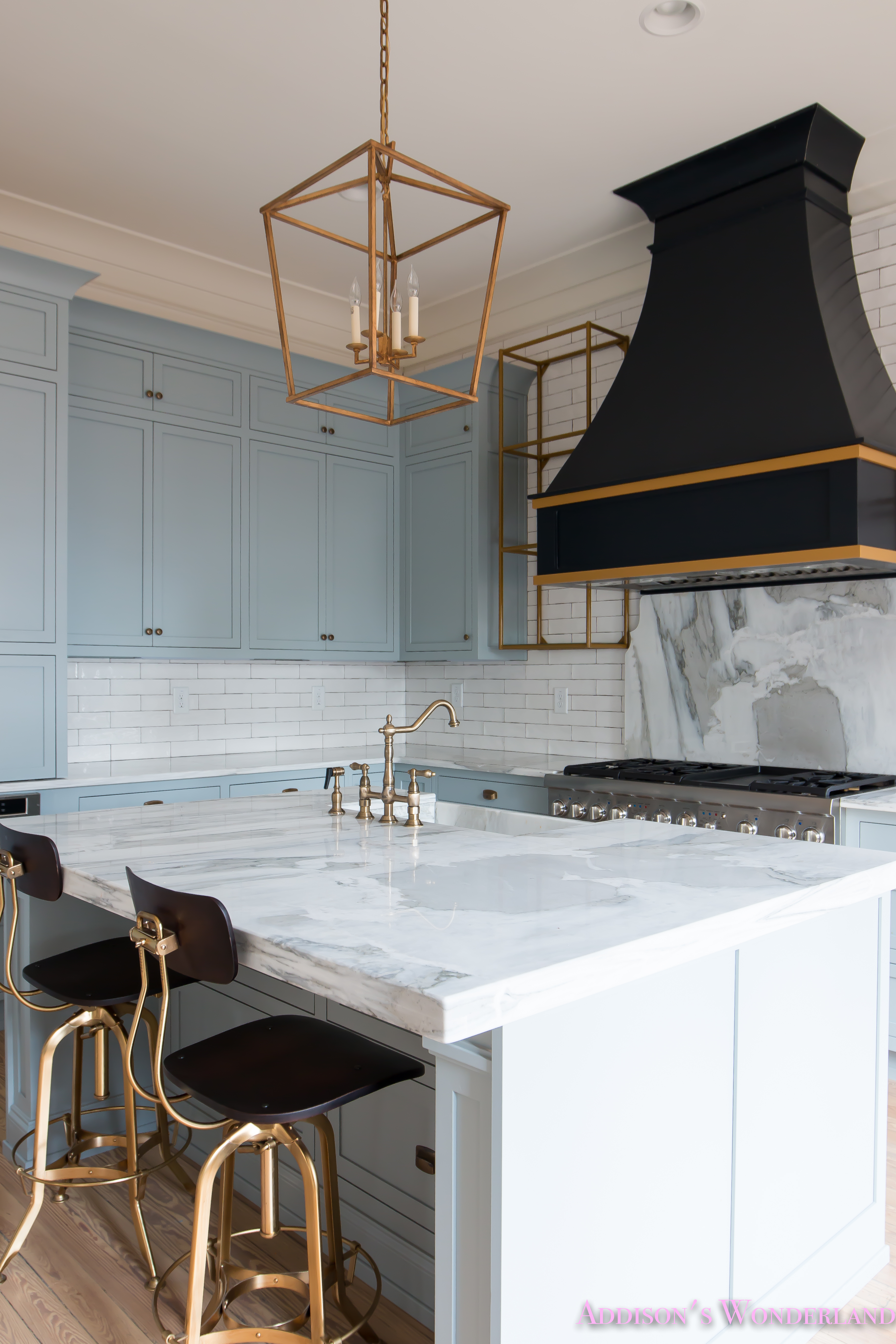a-classic-vintage-modern-kitchen-blue-gray-cabinets-inset-shaker-black-gold-vent-hood-antique ...