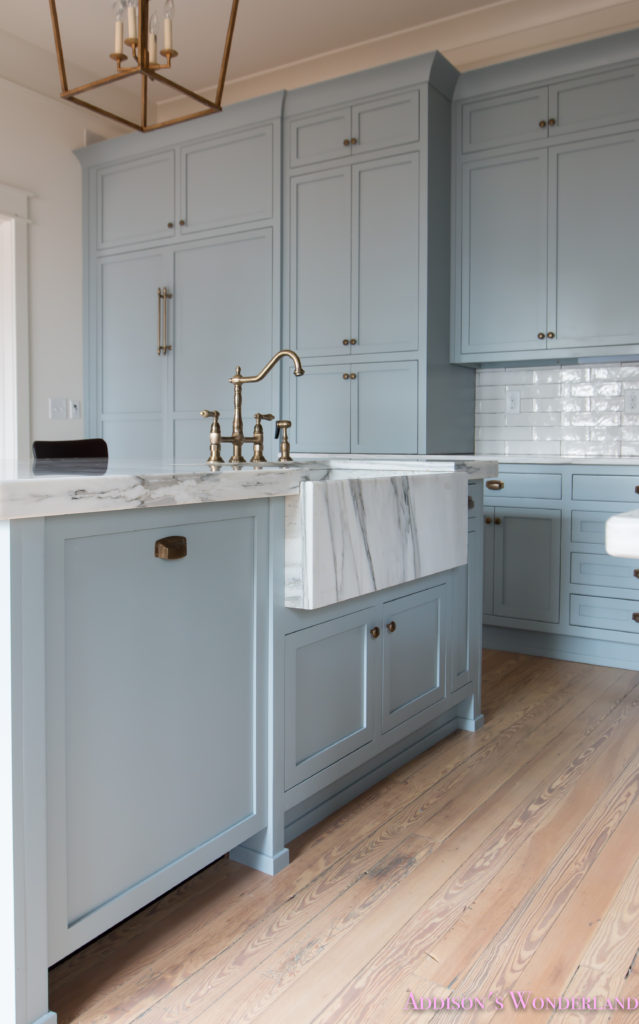 a-classic-vintage-modern-kitchen-blue-gray-cabinets-inset-shaker-black-gold-vent-hood-antique-brass-faucet-white-subway-backsplash-tile-gold-open-shelves-13-of-16