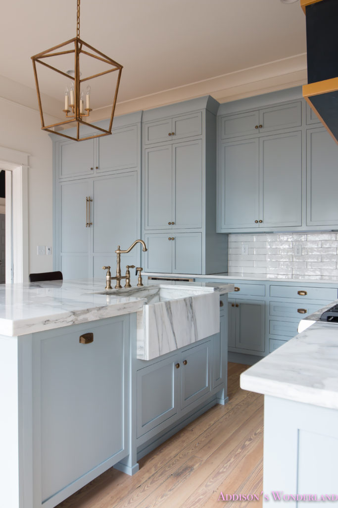 a-classic-vintage-modern-kitchen-blue-gray-cabinets-inset-shaker-black-gold-vent-hood-antique-brass-faucet-white-subway-backsplash-tile-gold-open-shelves-15-of-16