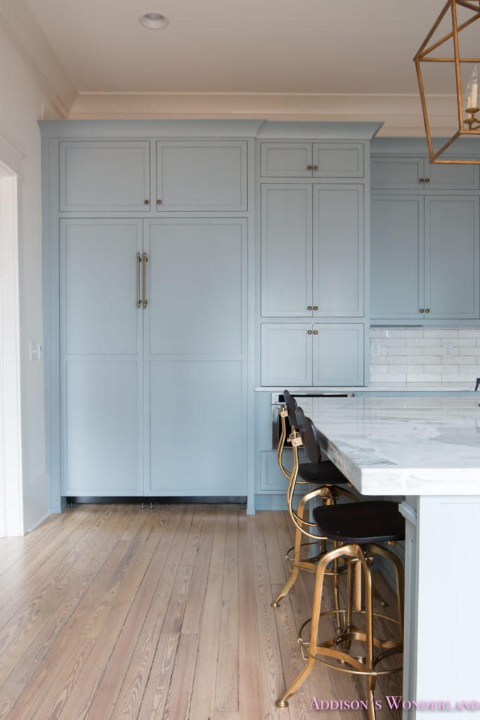 a-classic-vintage-modern-kitchen-blue-gray-cabinets-inset-shaker-black-gold-vent-hood-antique-brass-faucet-white-subway-backsplash-tile-gold-open-shelves-16-of-16