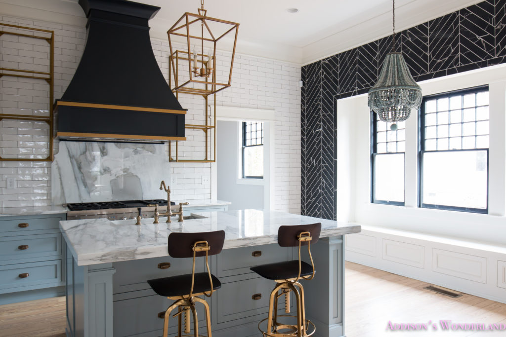 a-classic-vintage-modern-kitchen-blue-gray-cabinets-inset-shaker-black-gold-vent-hood-antique-brass-faucet-white-subway-backsplash-tile-gold-open-shelves-5-of-16