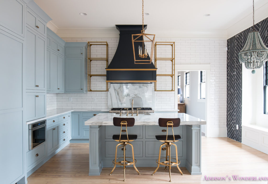 a-classic-vintage-modern-kitchen-blue-gray-cabinets-inset-shaker-black-gold-vent-hood-antique-brass-faucet-white-subway-backsplash-tile-gold-open-shelves-6-of-16