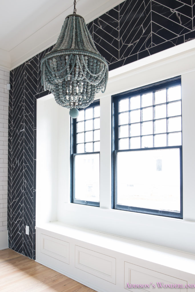 a-classic-vintage-modern-kitchen-blue-gray-cabinets-inset-shaker-black-gold-vent-hood-antique-brass-faucet-white-subway-backsplash-tile-gold-open-shelves-7-of-16