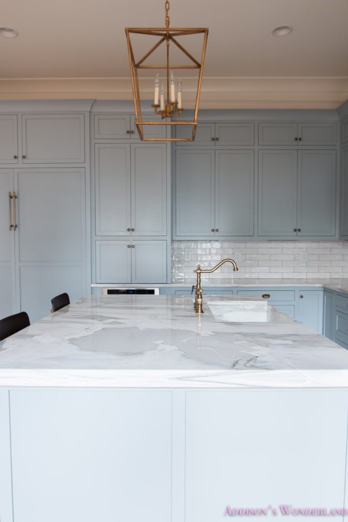a-classic-vintage-modern-kitchen-blue-gray-cabinets-inset-shaker-black-gold-vent-hood-antique-brass-faucet-white-subway-backsplash-tile-gold-open-shelves-8-of-16