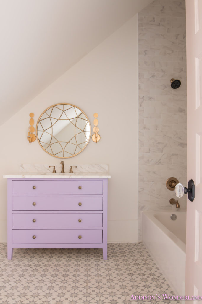 alabaster-walls-girls-bathroom-white-porcelain-marble-subway-tile-cement-tile-patterned-antique-brass-faucet-purple-vanity-cabinet-2-of-6