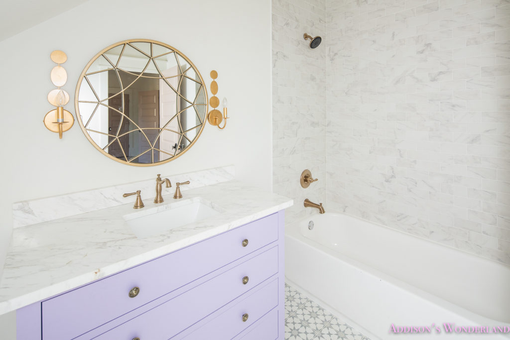 alabaster-walls-girls-bathroom-white-porcelain-marble-subway-tile-cement-tile-patterned-antique-brass-faucet-purple-vanity-cabinet-3-of-4