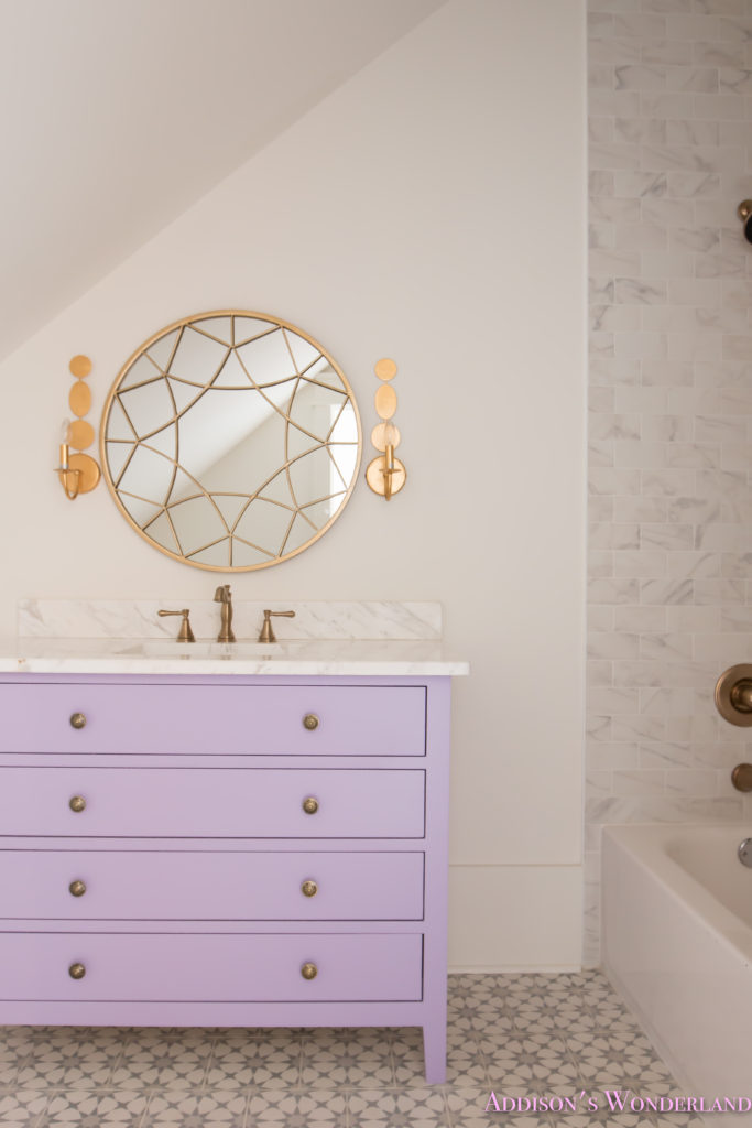 alabaster-walls-girls-bathroom-white-porcelain-marble-subway-tile-cement-tile-patterned-antique-brass-faucet-purple-vanity-cabinet-3-of-6