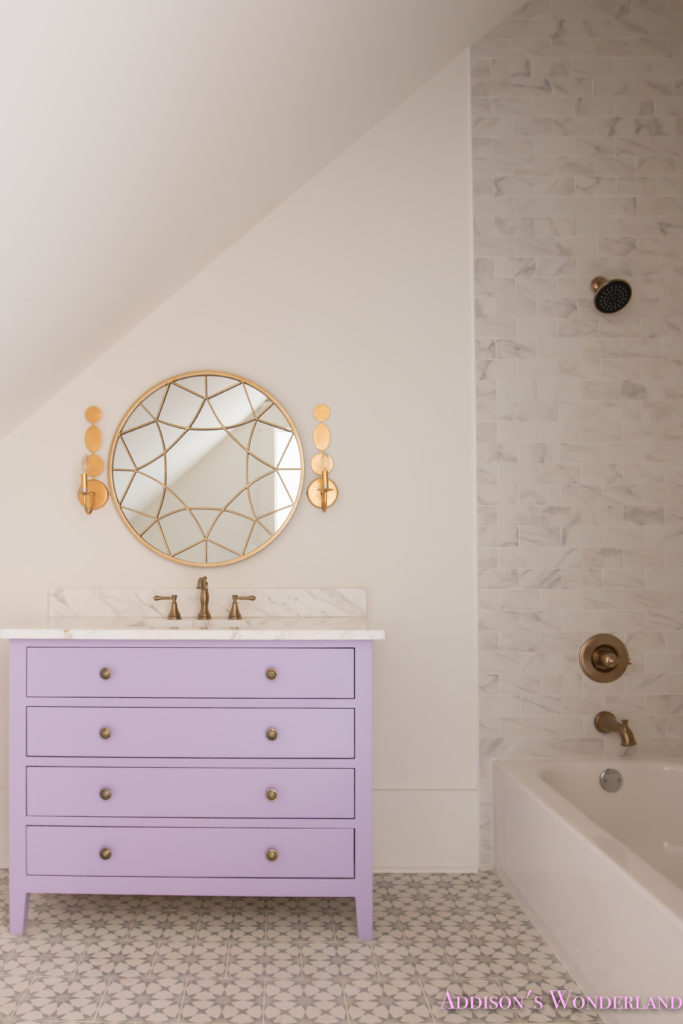 alabaster-walls-girls-bathroom-white-porcelain-marble-subway-tile-cement-tile-patterned-antique-brass-faucet-purple-vanity-cabinet-6-of-6