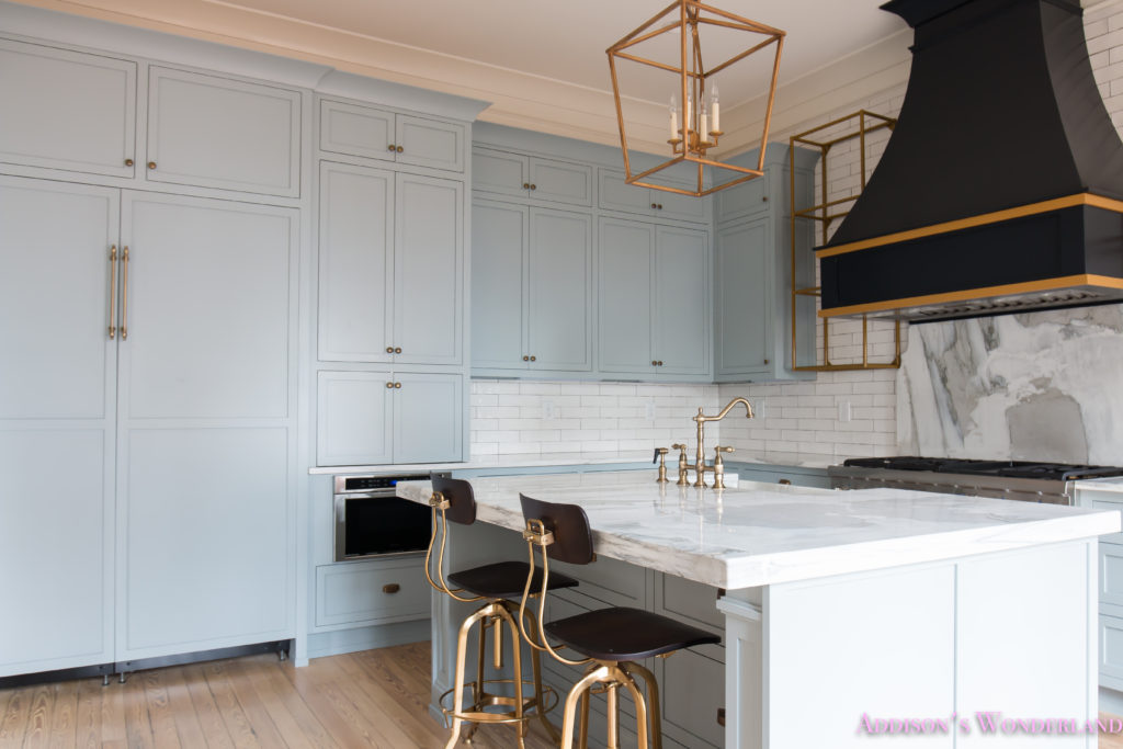 classic-vintage-modern-kitchen-blue-gray-cabinets-inset-shaker-black-gold-vent-hood-antique-brass-faucet-white-subway-backsplash-tile-gold-open-shelves-16-of-18