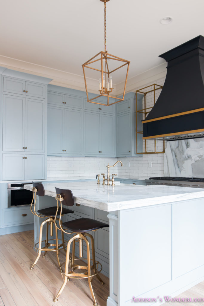 classic-vintage-modern-kitchen-blue-gray-cabinets-inset-shaker-black-gold-vent-hood-antique-brass-faucet-white-subway-backsplash-tile-gold-open-shelves-17-of-18