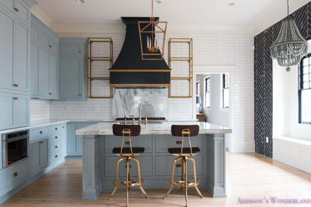 classic-vintage-modern-kitchen-blue-gray-cabinets-inset-shaker-black-gold-vent-hood-antique-brass-faucet-white-subway-backsplash-tile-gold-open-shelves-3-of-18