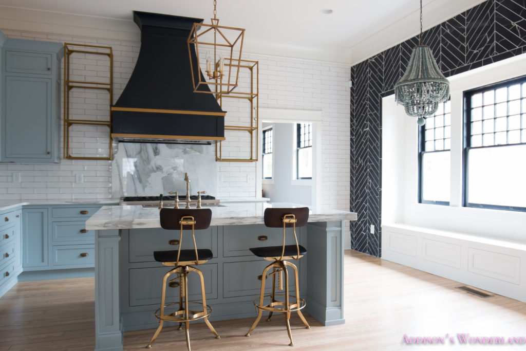 classic-vintage-modern-kitchen-blue-gray-cabinets-inset-shaker-black-gold-vent-hood-antique-brass-faucet-white-subway-backsplash-tile-gold-open-shelves-4-of-18