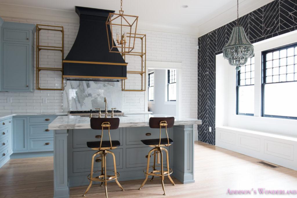 classic-vintage-modern-kitchen-blue-gray-cabinets-inset-shaker-black-gold-vent-hood-antique-brass-faucet-white-subway-backsplash-tile-gold-open-shelves-4-of-18