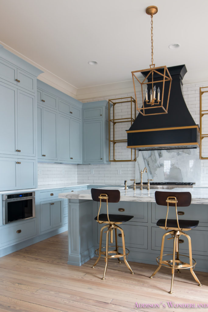 classic-vintage-modern-kitchen-blue-gray-cabinets-inset-shaker-black-gold-vent-hood-antique-brass-faucet-white-subway-backsplash-tile-gold-open-shelves-6-of-18