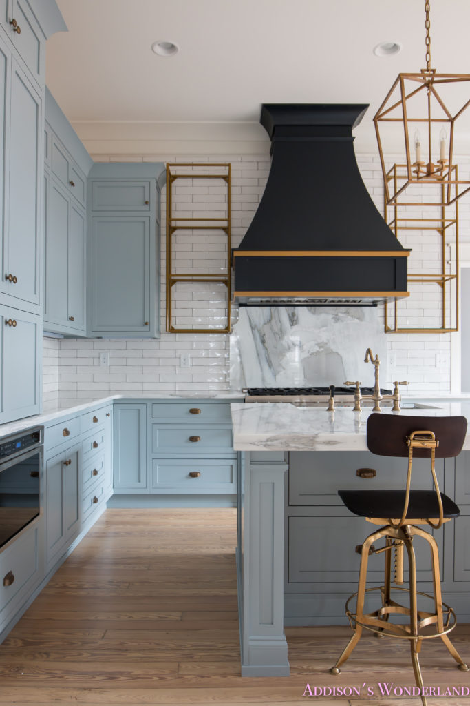 classic-vintage-modern-kitchen-blue-gray-cabinets-inset-shaker-black-gold-vent-hood-antique-brass-faucet-white-subway-backsplash-tile-gold-open-shelves-8-of-18