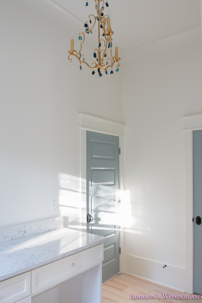 master-closet-dressing-room-alabaster-walls-vanity-bue-gray-door-chandelier-4-of-8