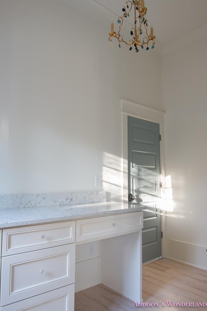 master-closet-dressing-room-alabaster-walls-vanity-bue-gray-door-chandelier-5-of-8
