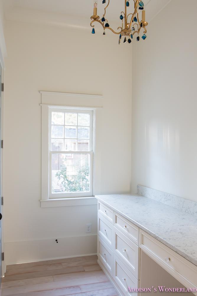 master-closet-dressing-room-alabaster-walls-vanity-bue-gray-door-chandelier-7-of-8